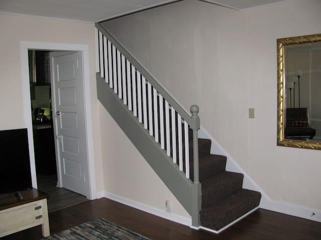 View of staircase, Kitchen through open doorway.
