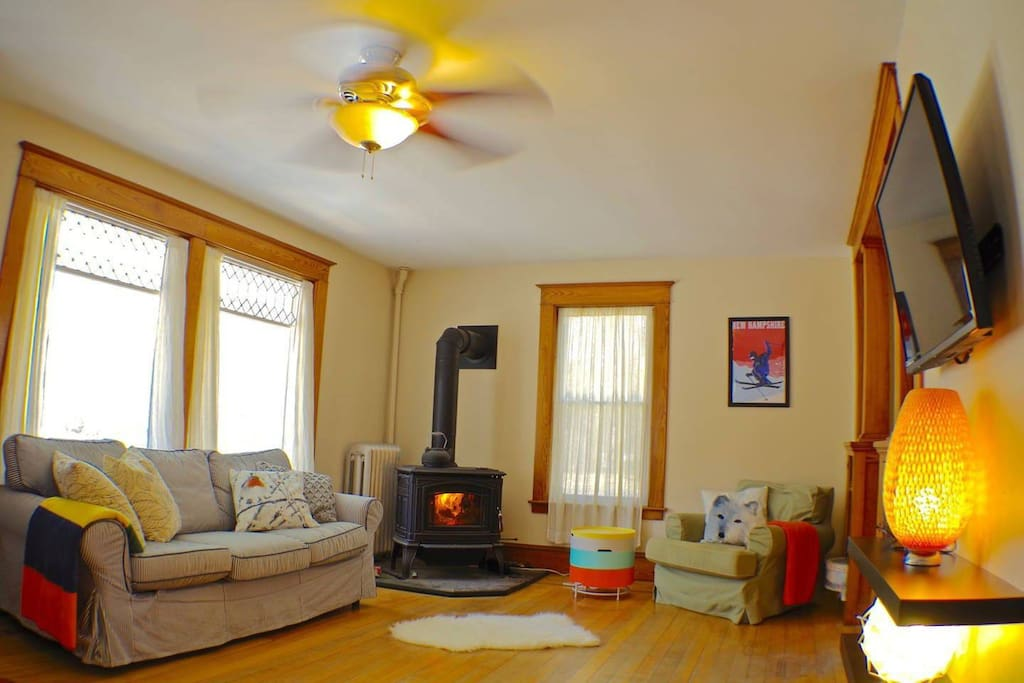 Relax in the living room by the wood stove-- or flatscreen tv
