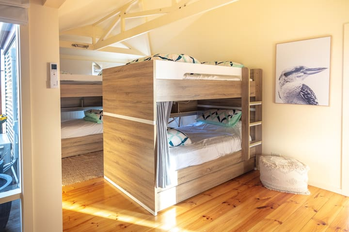The bunk room houses two king single bunks with quality mattresses and bedding, and roll away trundle beds for 2 extra guests. Heated and cooled with reverse cycle aircon and also has a Smart TV and nook for some downtime