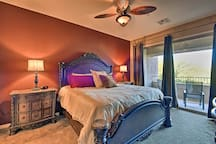 The master bedroom has access to a covered balcony.