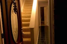 Your room awaits you up these stairs and to the left!
