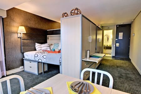 2 beds in a hotel room type space!