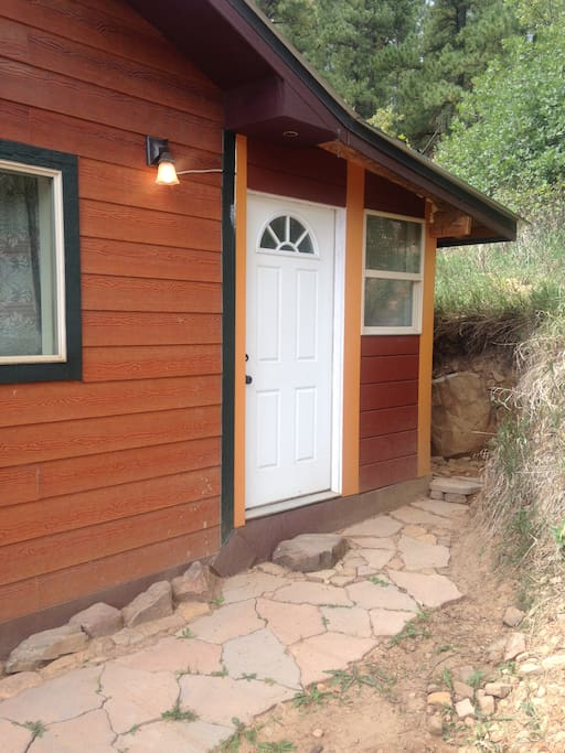 This is your private entrance at the east side of the house. I am in the process of enclosing the back deck to make a kitchenette for my guests