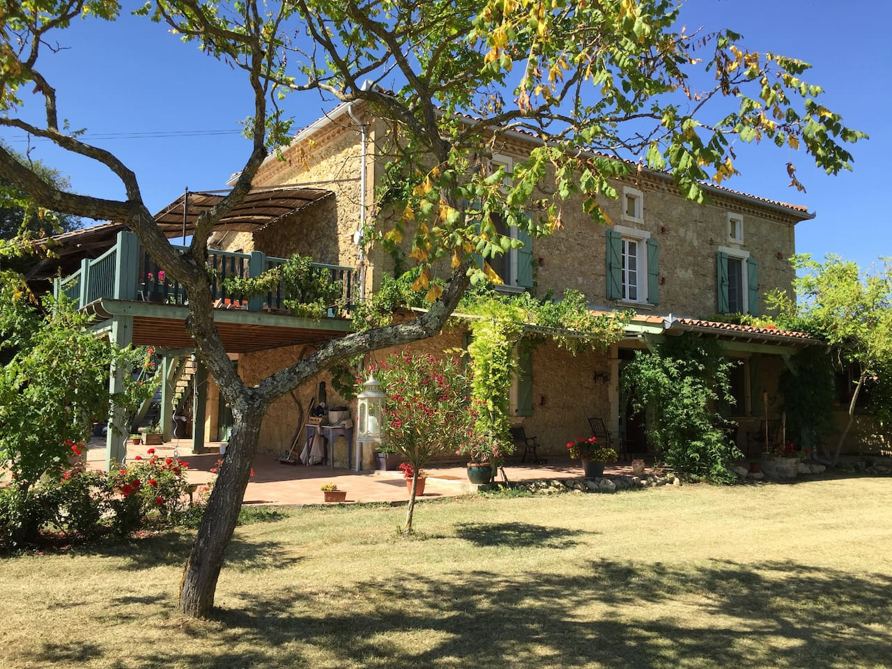 The main house with the balcony of Gite Les Pyrénées  which has been skillfully converted from the former hayloft.
