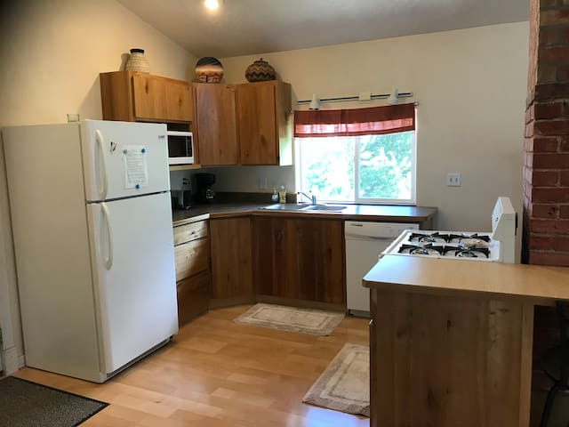Small kitchen with dishwasher that works well (rinse first); microwave, gas stove and oven, and fridge with bottled water.
