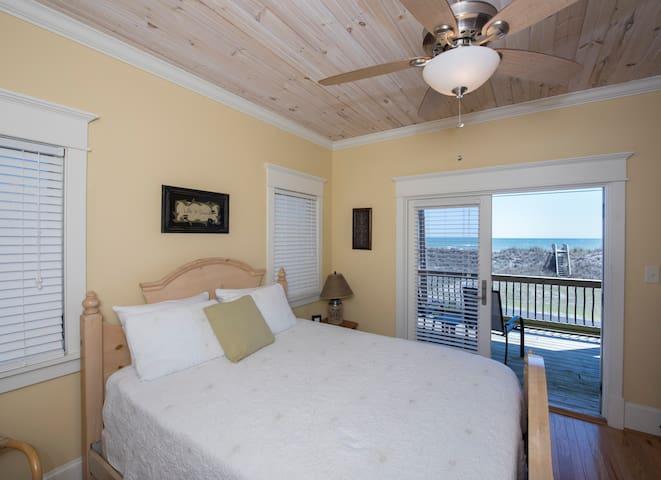Queen bedroom has ocean views and deck access.