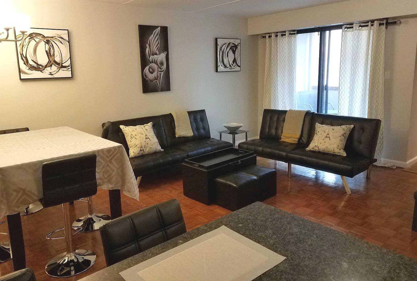 Spacious open-space LR / DR area with adjoining balcony.