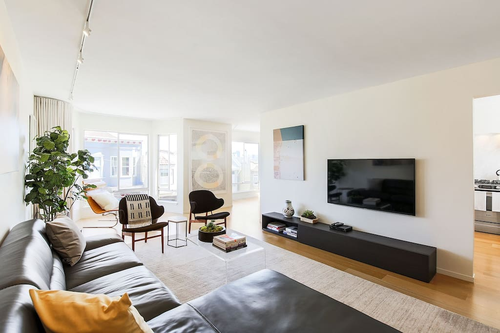 """Have a seat and watch your favorite shows on the 55"""" LED flatscreen smart TV, with cable and internet streaming services."""