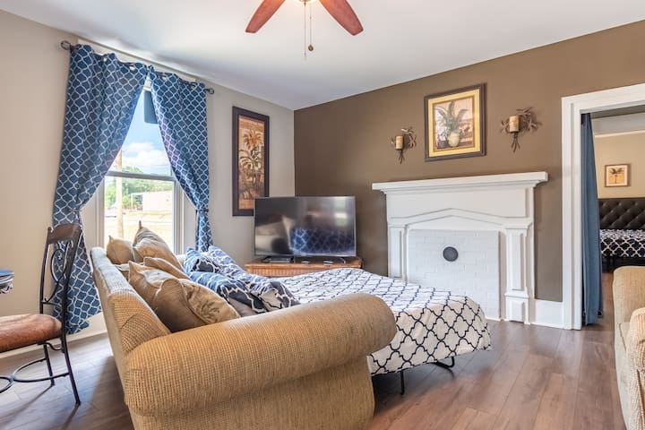 Pull out queen size sofa in living room with brand new pillowtop comforter, sheets and quilt.