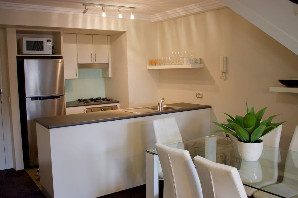Fully equipped kitchen and large dining table