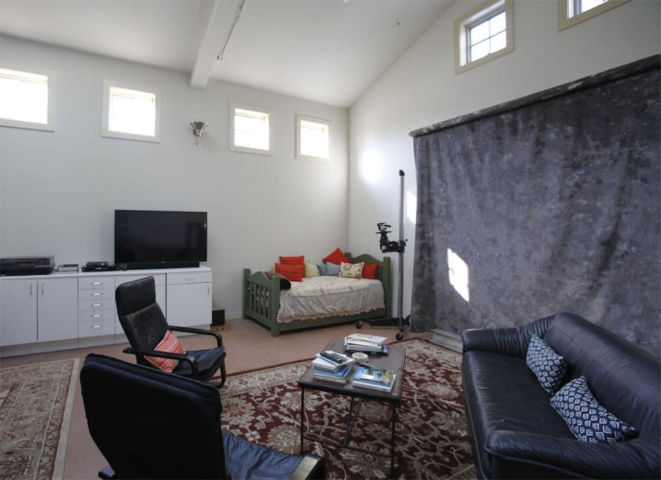 Living room area with big screen and trundle bed