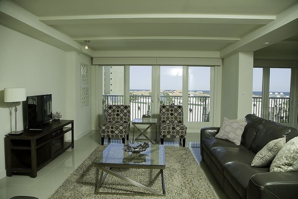 Enjoy your favorite shows or just a simple movie night on this spacious living room elegantly decorated with leather sofas design to comfort you and your loved ones. Internet and basic cable is provided.