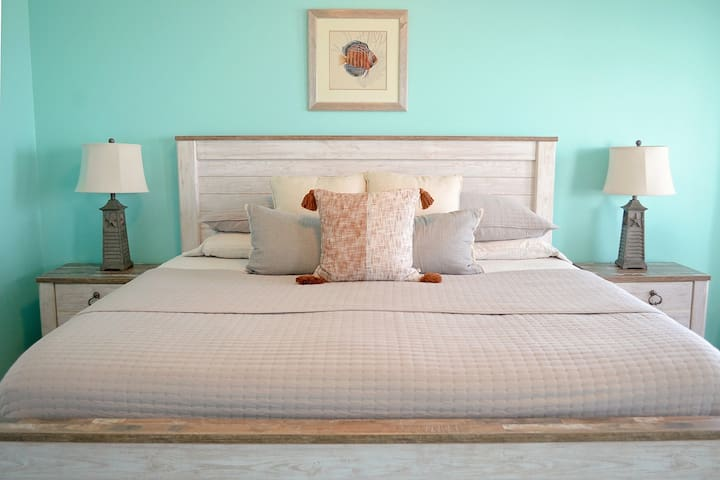 The master bedroom is located upstairs and has soft linens and a king-sized bed.  Relax and revitalize after a great day at the beach.