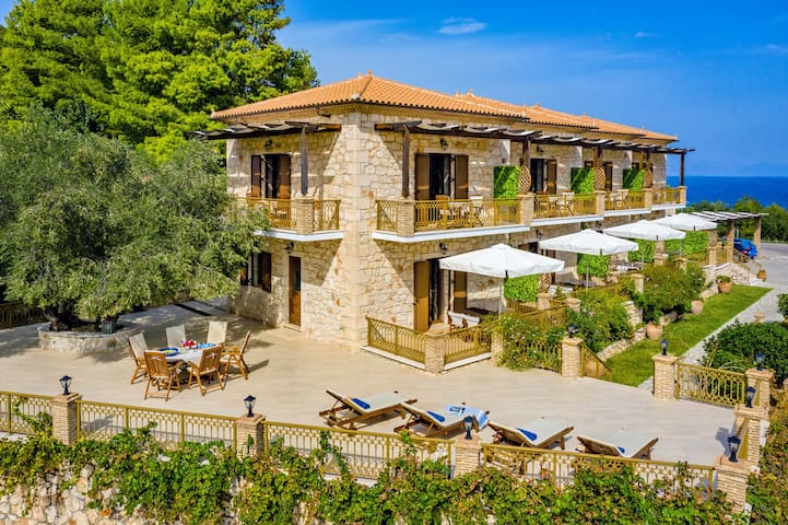 enjoy the sunbed area and lovely large terrace with a table under the olive tree