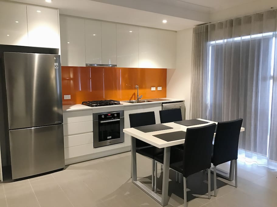 Well equip kitchen with lots of cooking utensils and appliances.