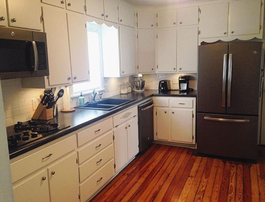 Full kitchen with gas stove, oven, dishwasher & refrigerator.