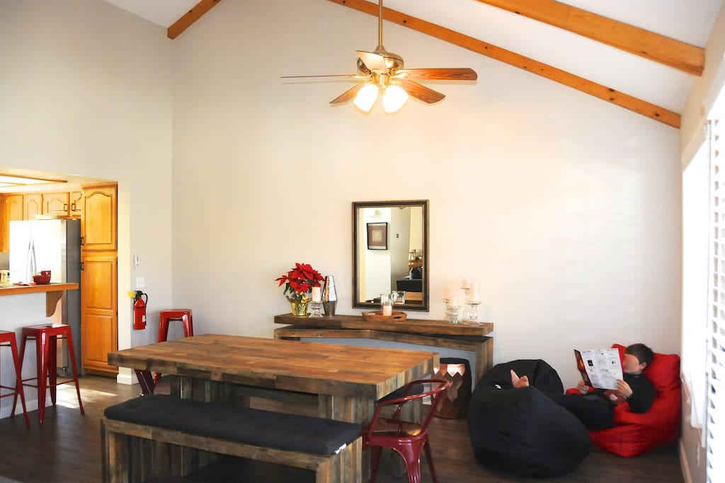 "Reclaimed wood table and benches plus kitchen bar provide seating for all. ""Beanbag Corner"" in the dining room is perfect for a card game or a good book."