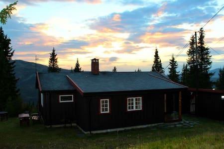 Fjelltun is a restored, traditional log cabin