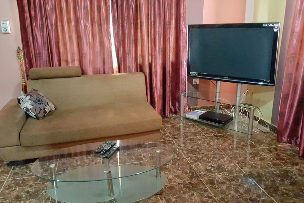 Living room with cable TV, dining table and air conditioner