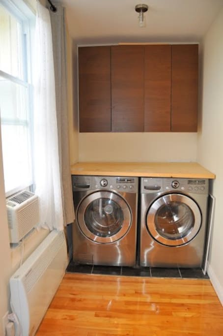 New high efficiency washer and dryer inside the apartment.