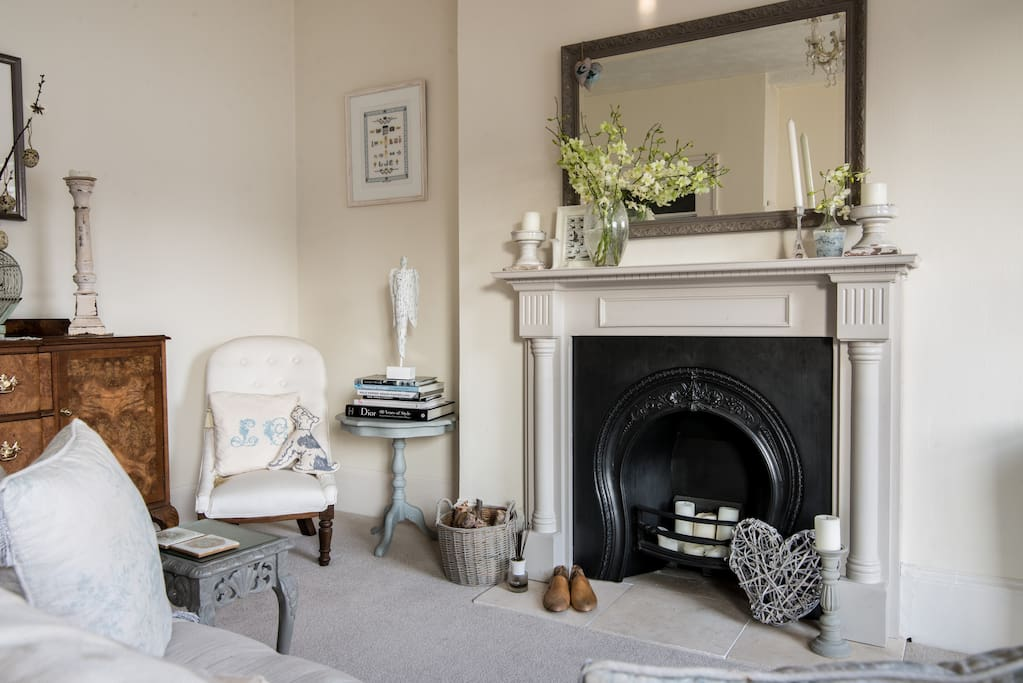 a cosy nook to enjoy a book and a beautiful original regency fireplace.