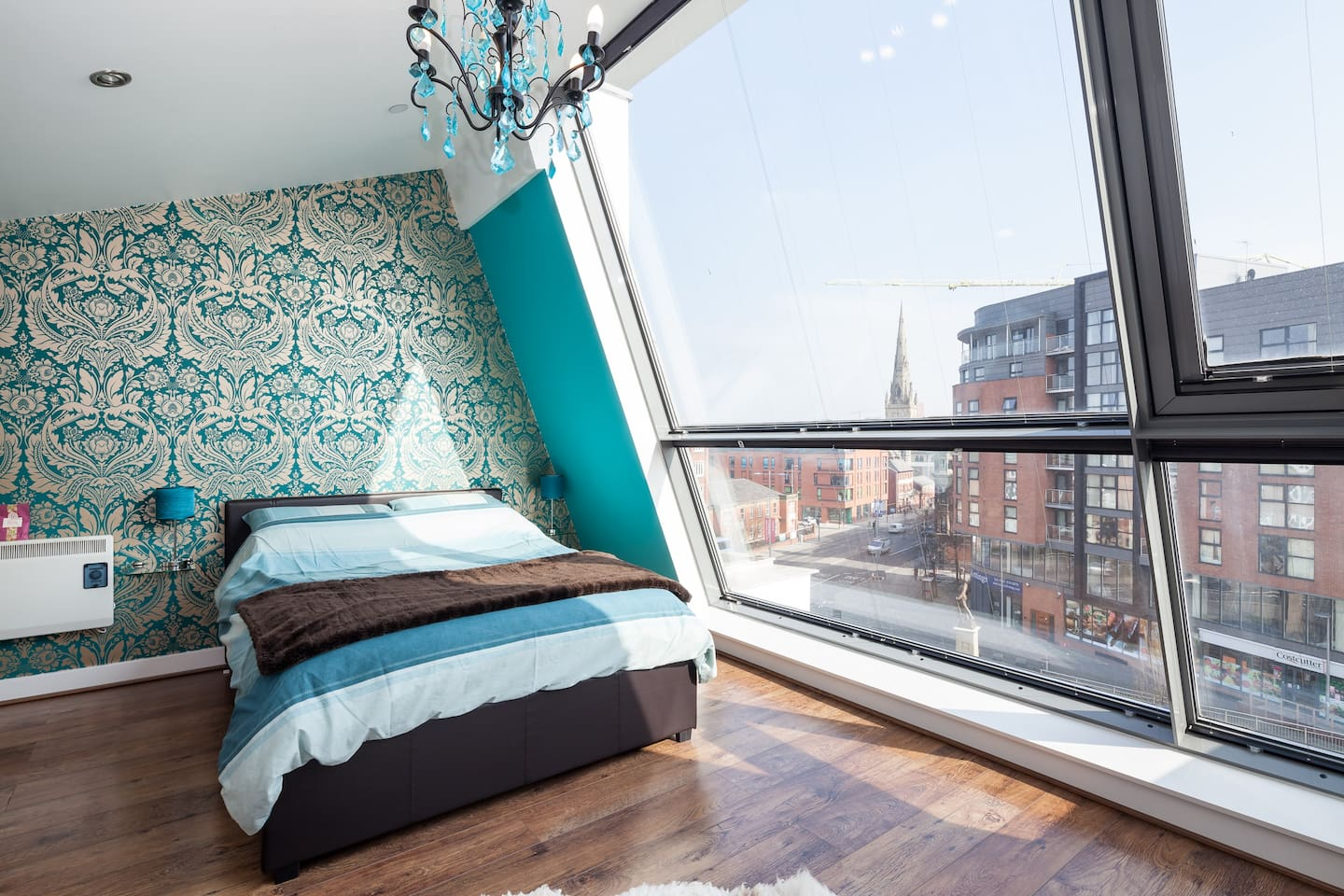 The Master bedroom with full length windows and great views