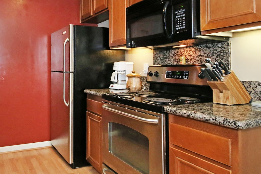 Kitchen - Stainless steel appliances and all the things you need to cook up a storm
