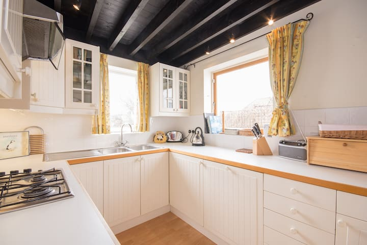 Well appointed kitchen with gas hob, electric oven, double sink and dishwasher.