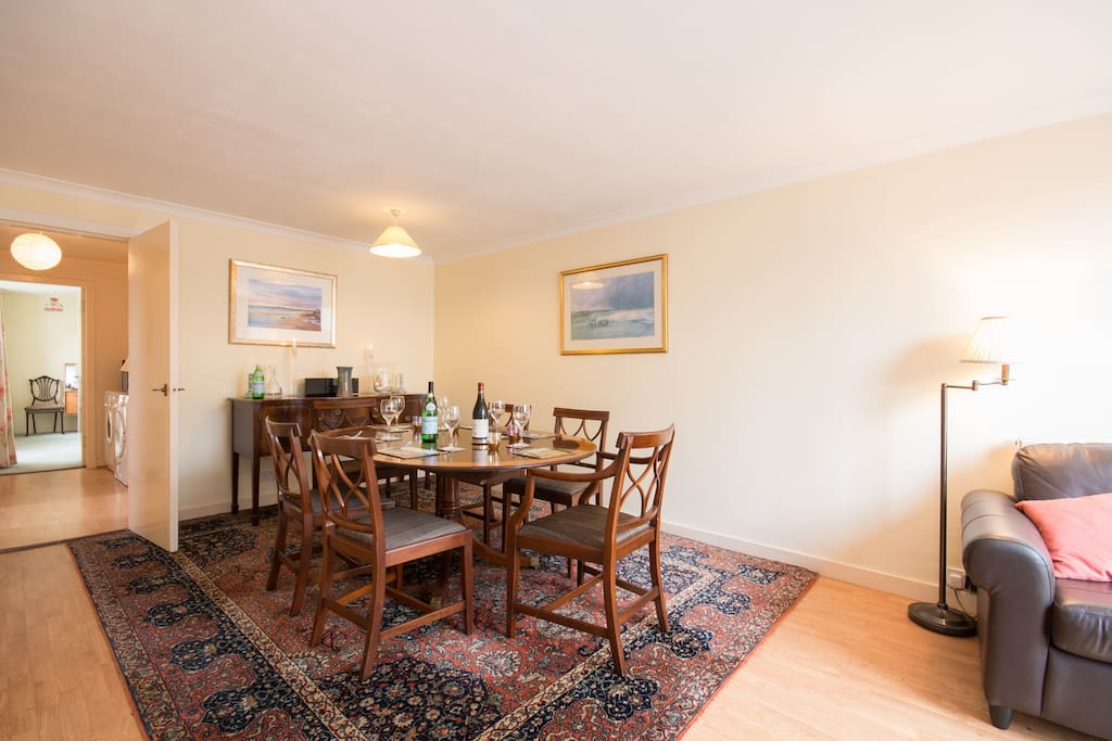 A separate dining room also has a small work space and seating area so there is always lots of space for everyone.