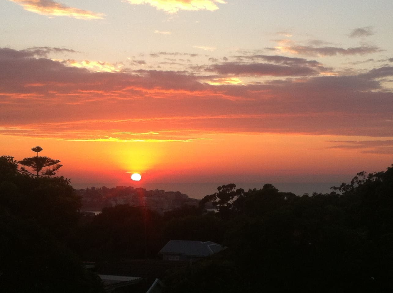 Sunrise over the ocean, view from our sitting room.