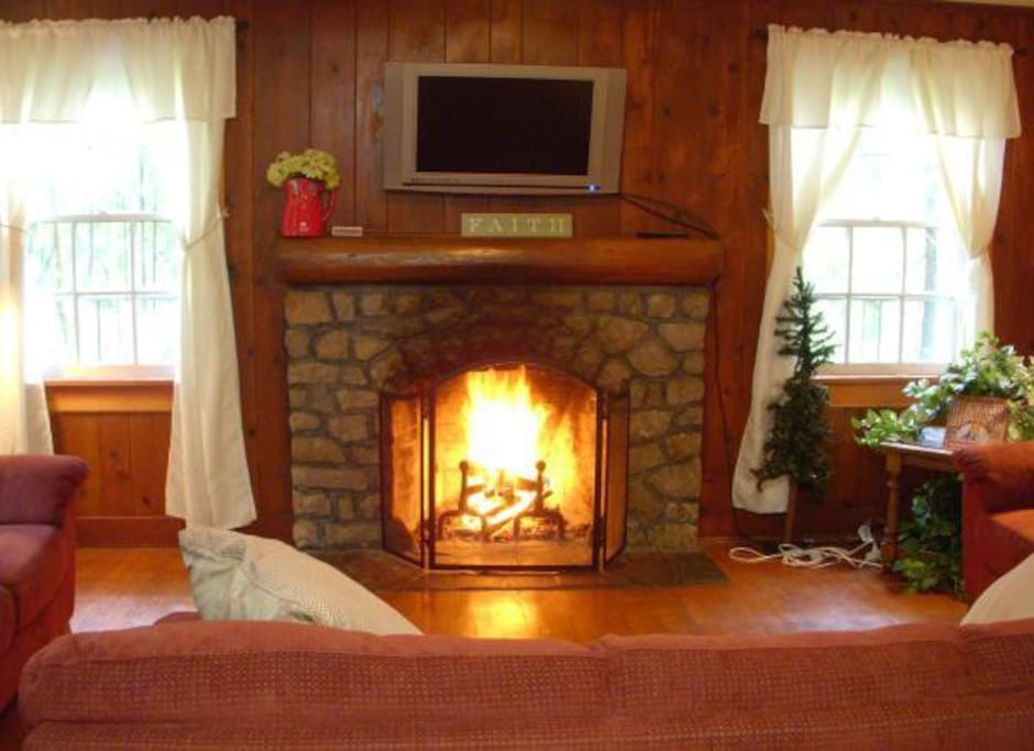 Snuggle by a roaring fire in our hand stacked stone fireplace.