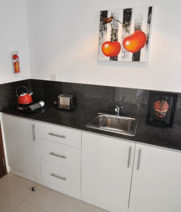 Kitchen, includes small fridge, gas cooker.