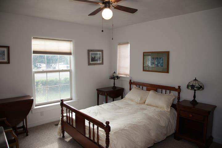 A sunny cozy bedroom.