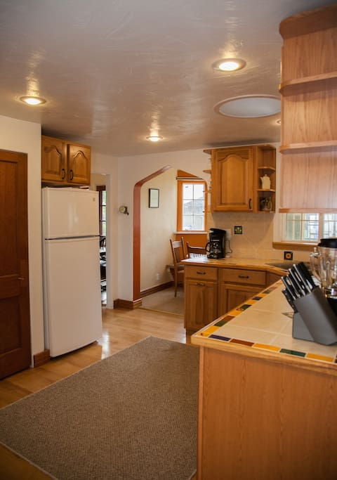 It is a full size, full service kitchen with a breakfast nook at one end.