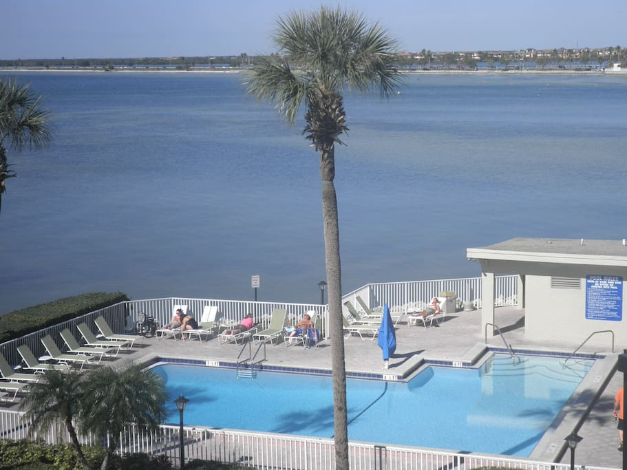 Condo's large heated pool with a beautiful waterfront view.