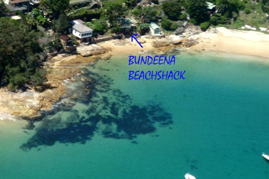 Helicopter view showing the Beachshack perched on the beachfront