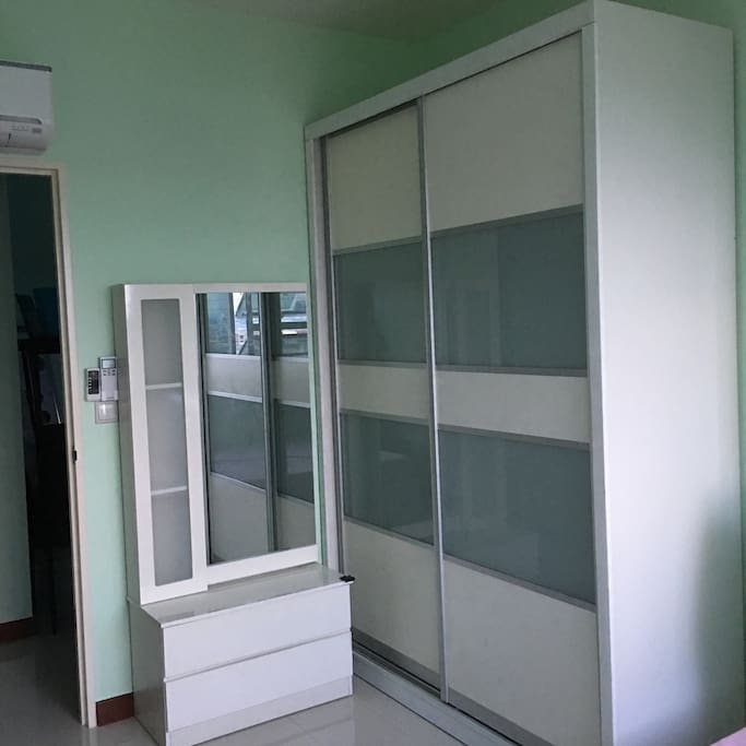 Room with cupboard, dressing table and aircon