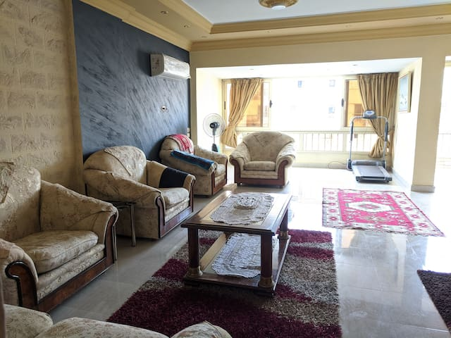 Very spacious living room with panoramic windows overlooking the lively streets of downtown Cairo. There is also a newly-installed Carrier AC. For those who like indoor sports, there's a treadmill that you can use while enjoying the panoramic view.