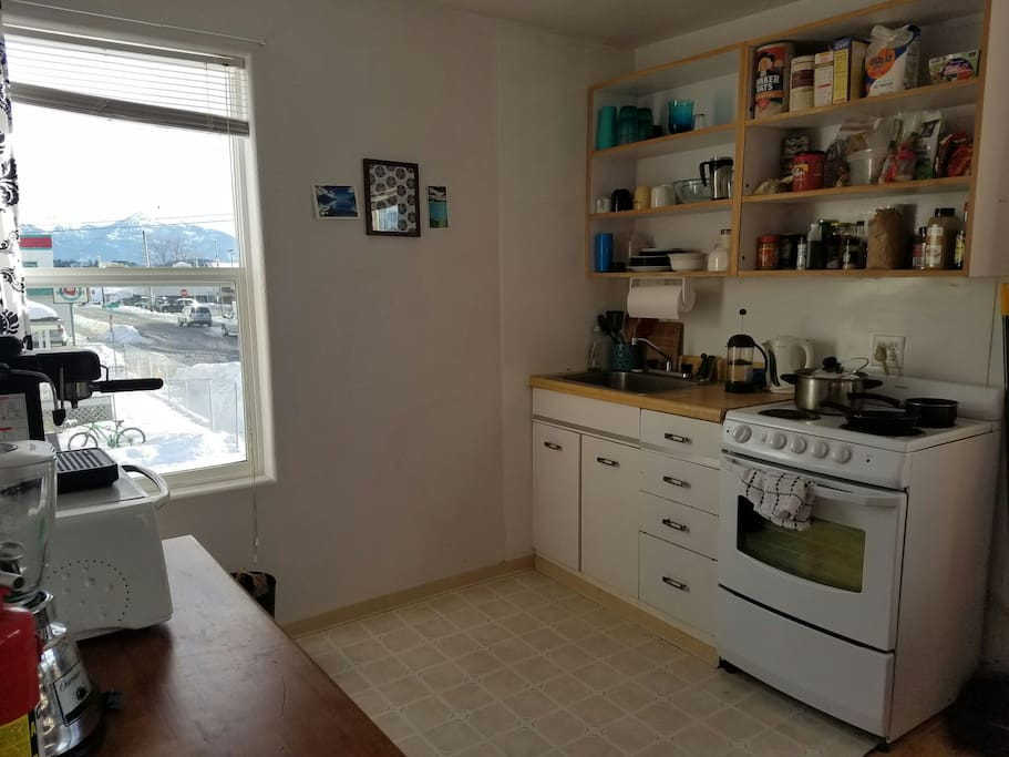 Kitchen, armed with spices, oil, some staples, and a nice mountain & ocean view!