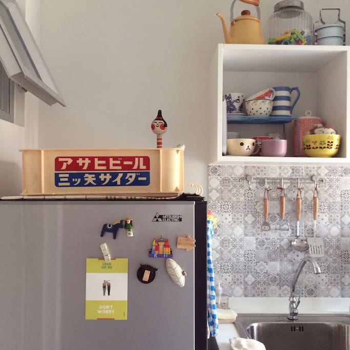 A tiny kitchen equipped with things you need.
