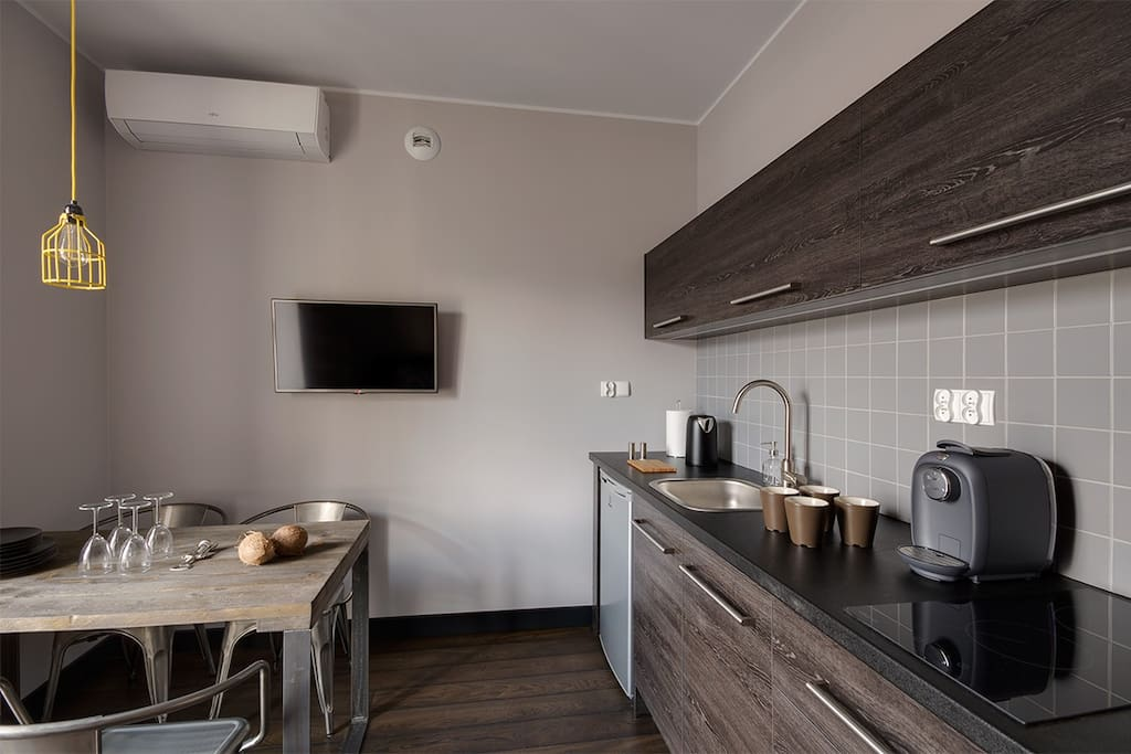 table for four and day zone with fully furnished kitchenette