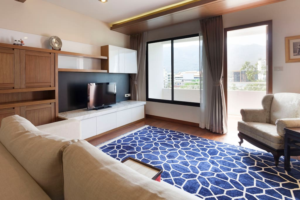 Large living room with the view of Doi Suthep. Sofa can be converted into a full size bed.