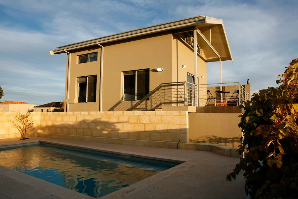 This is the free standing guest house. Pool blanket keeps pool warm many months of the year.