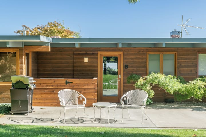 Entrance with outdoor seating, grill and access to nearby apricot orchard.