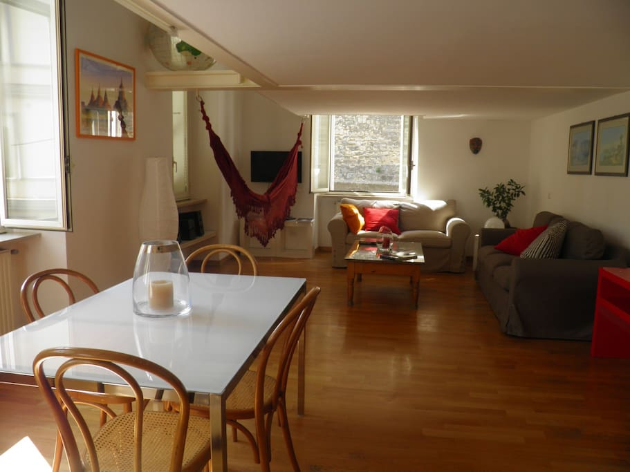 Our spacious and bright living room, with sofas and table for 6.