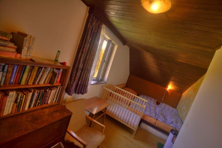 bedroom II, crib and backyard
