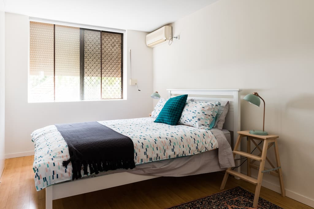 Bedroom Queen size bed and air conditioning