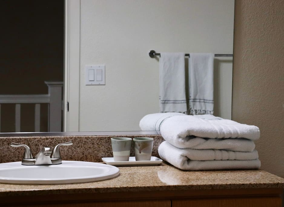 Across the hall is your private full bath with shower & tub. Fresh towels, soap, and shampoo provided.