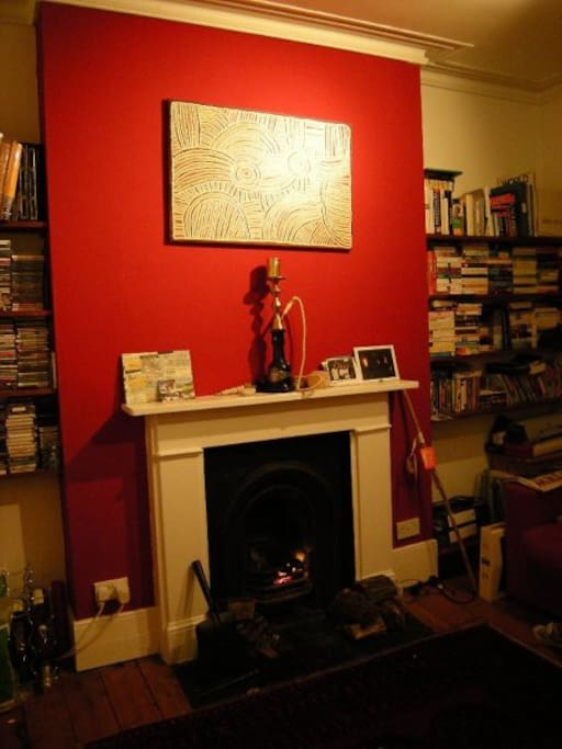 Fireplace and red wall.