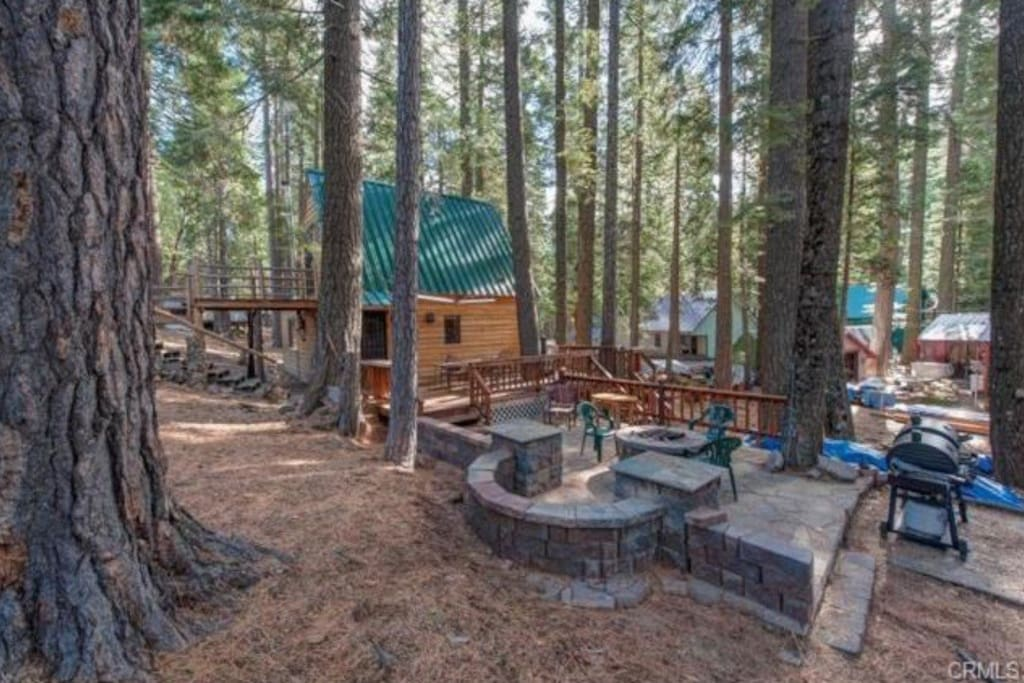 Large entertaining area outside with a fire pit & lots of seating